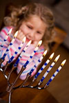 girl and menorah