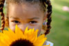 girl with braids and sunflower