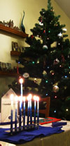 Christmas tree and lit Hanukkah menorah