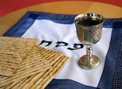 matzah, kiddush cup and matzah cover