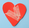 torn heart mended with tape