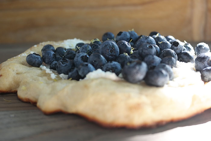 Closeup of blueberry pizza