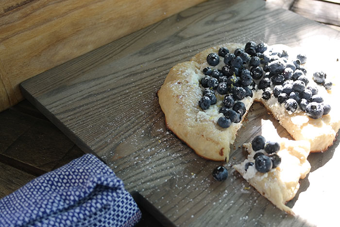 Serving of blueberry pizza