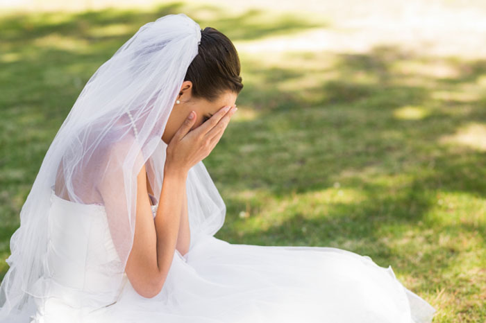 A bride is crying on her wedding day
