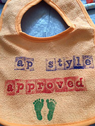 Liz makes the perfect bib for an editor mom-to-be