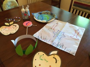Crafts: apples on a string, toilet-paper roll Torah, seder plate, challah cover, crown of leaves, gregor.
