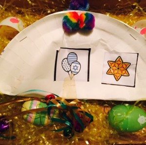Ruthie's Purim grogger nestling in with her Easter eggs
