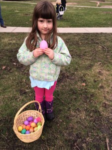 My daughter shows off her Easter egg hunt success.