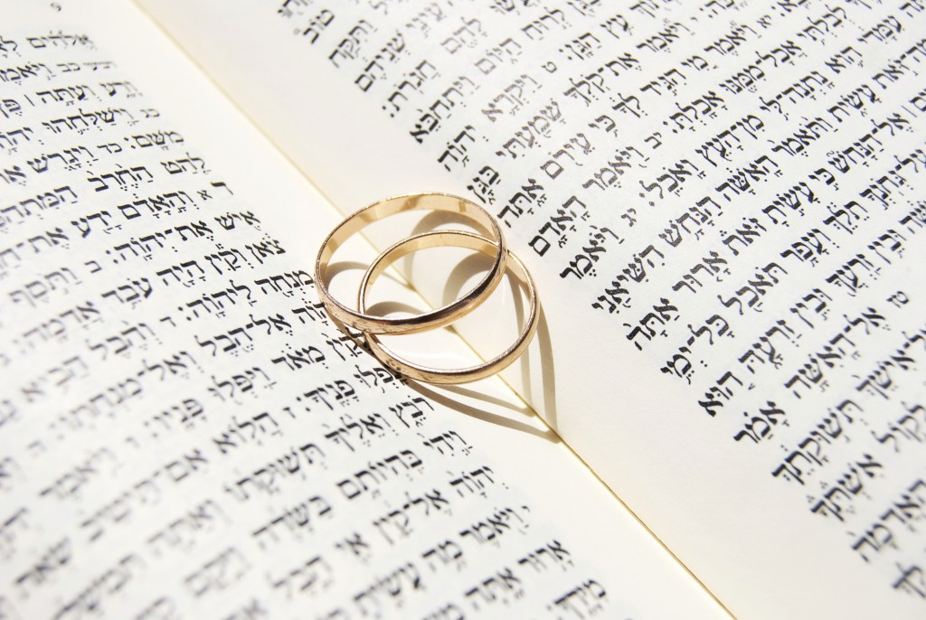 Wedding rings on the Torah