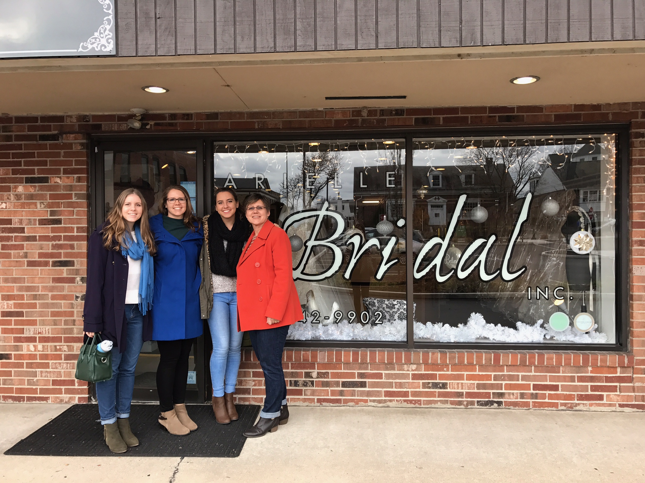 picture of four women in front of a bridal salon