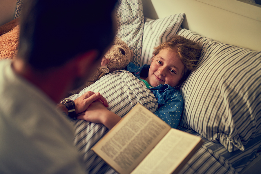 Reading book to daughter - content is about interfaith book recommendations for kids