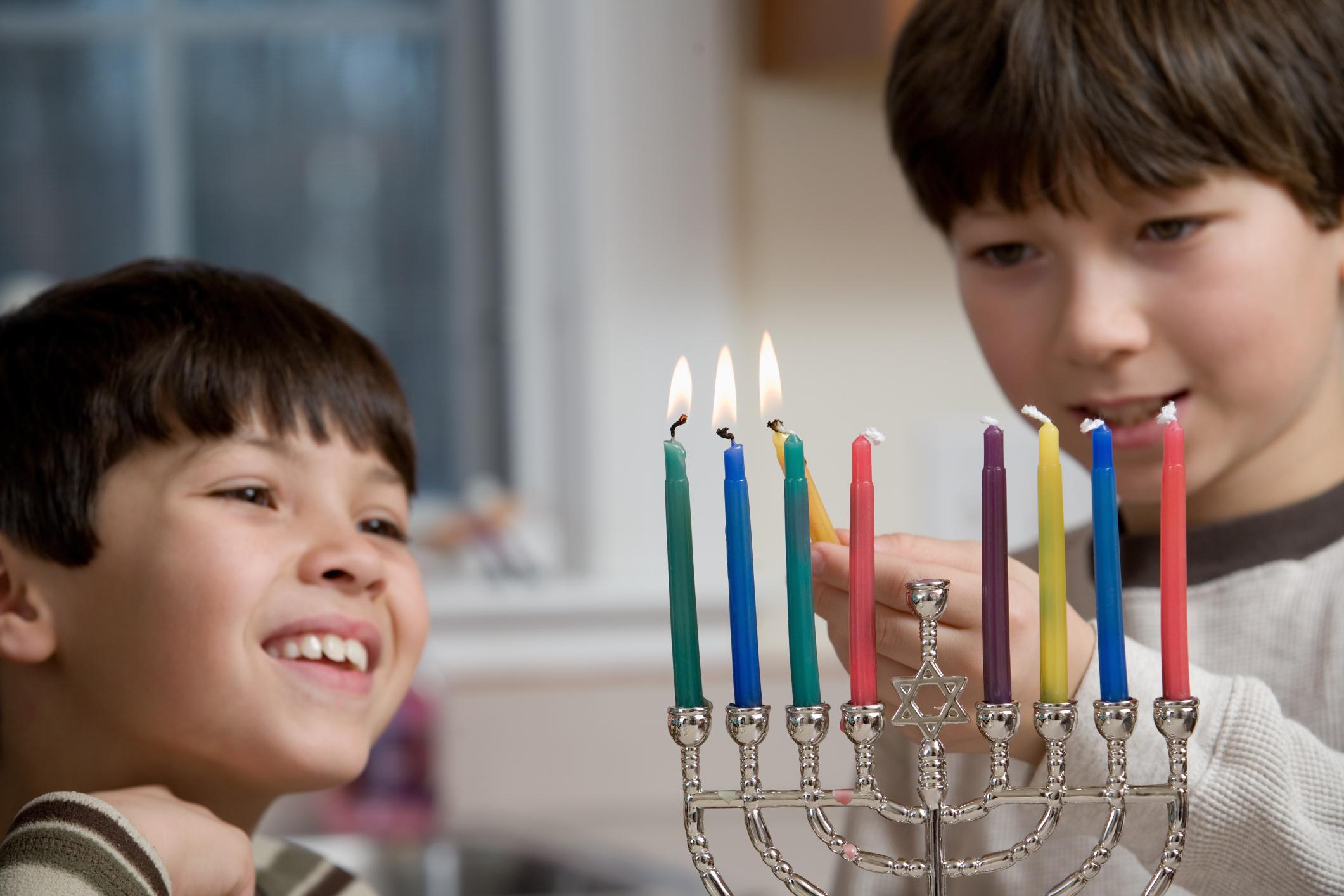 Boys Lighting The Menorah