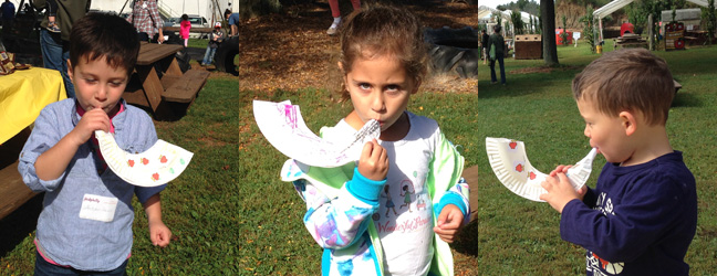 Children blowing the shofar