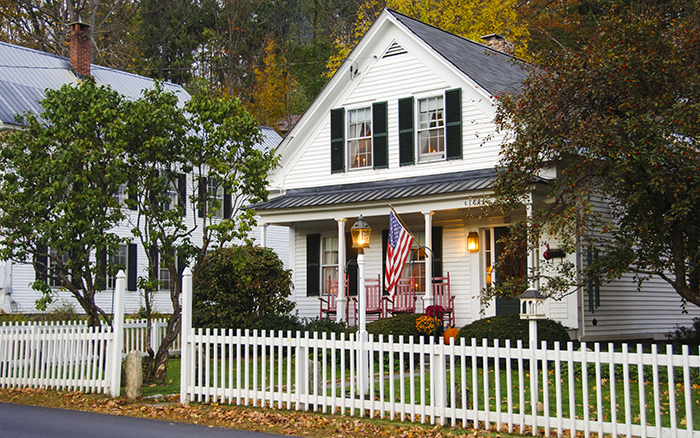 White picket fence and house