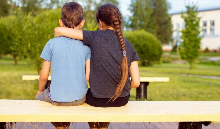 Boy and Girl in a side embrace
