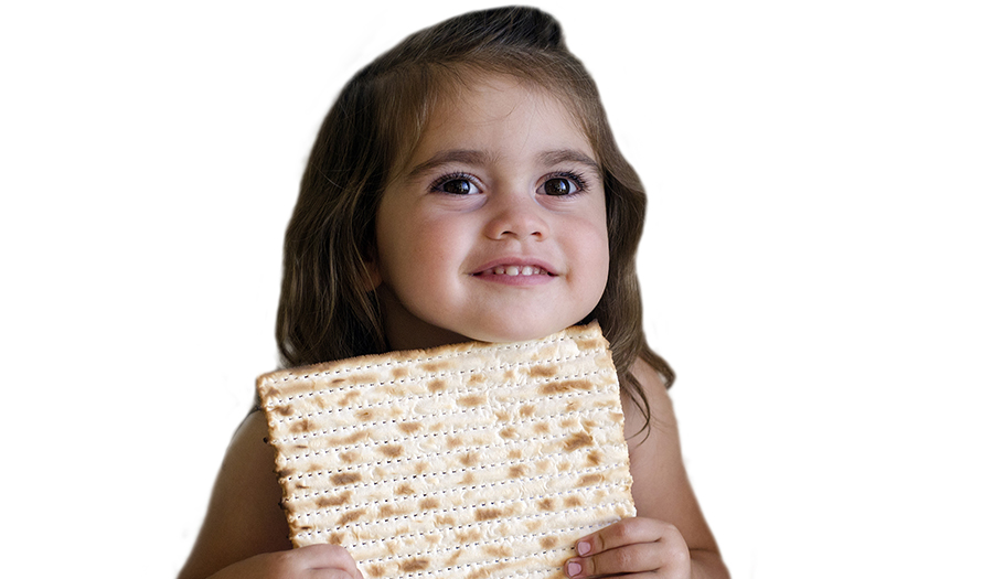 girl smiling and holding matzah for Passover