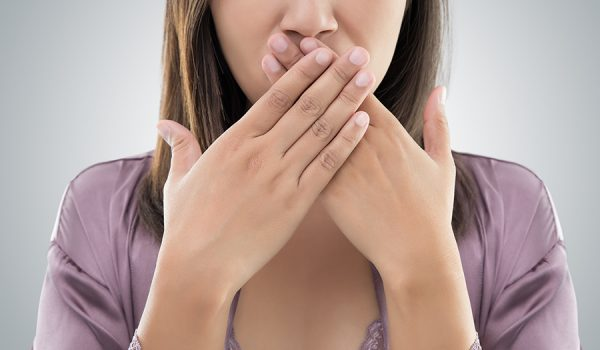 woman mouth covered