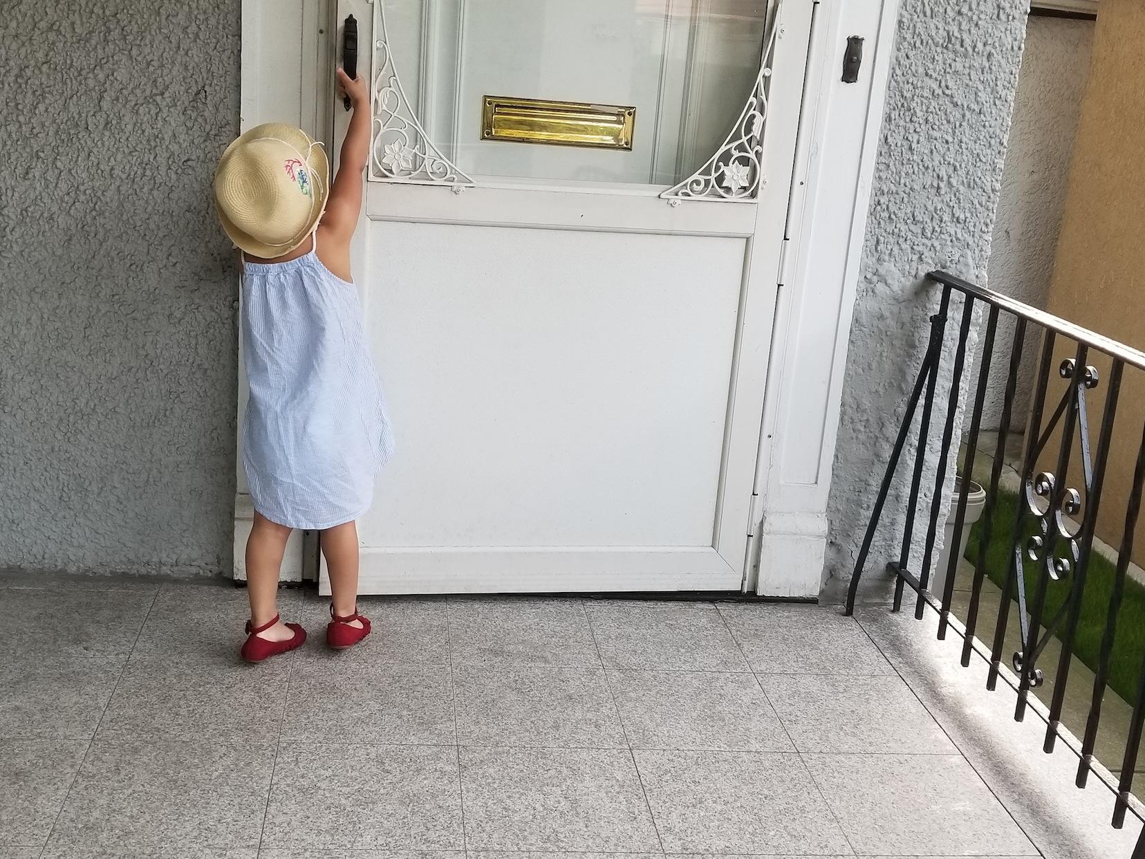 Helen opening a door