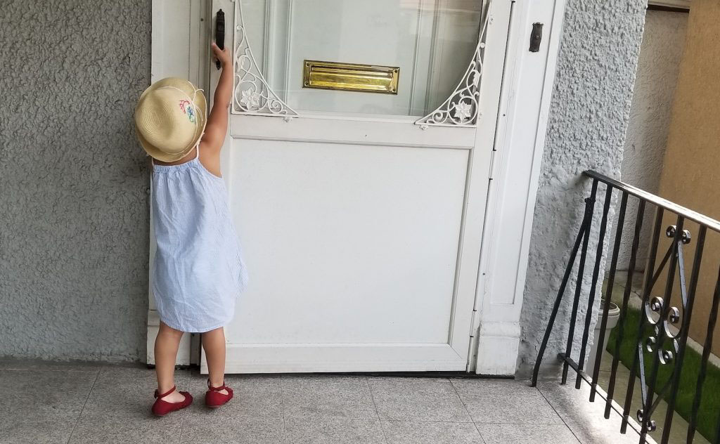 Anna's daughter opening a door