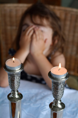 Child with Shabbat candles