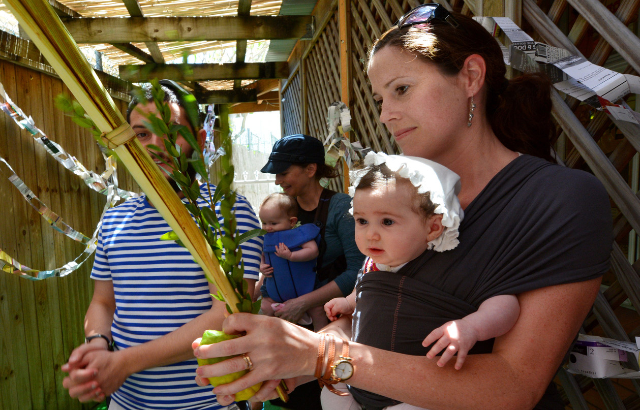 Families in a sukkah