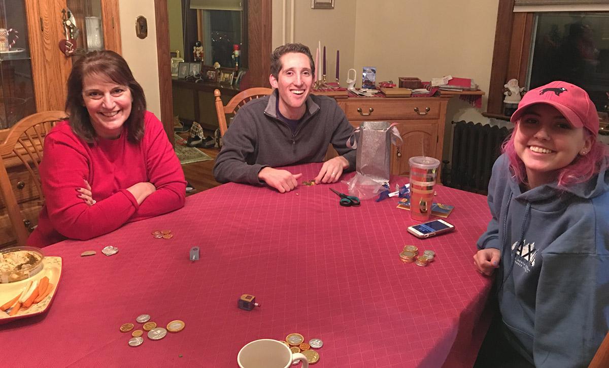 Laura teaches Zach to play dreidel