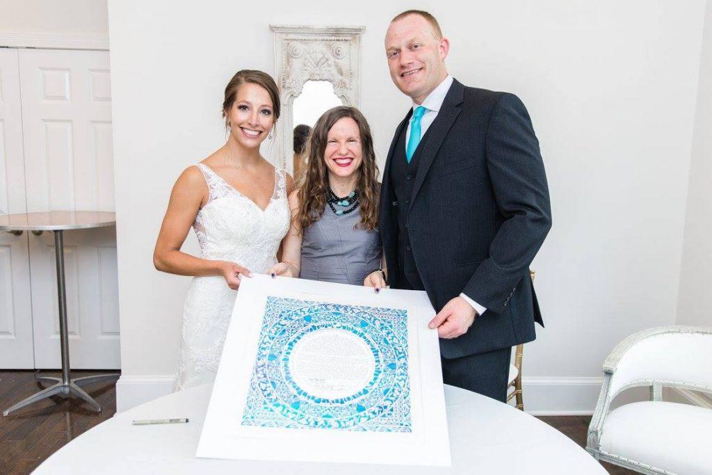 Malka and wedding couple with ketubah